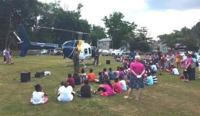 Englewood Police Treat Youngsters To Helicopter, Free Backpacks