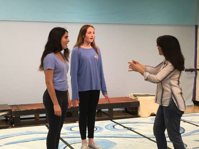 """Briarcliff Middle School students portraying Ariel and Ursula rehearse for this week's performances of """"The Little Mermaid Jr."""" with musical director Regina Leon."""