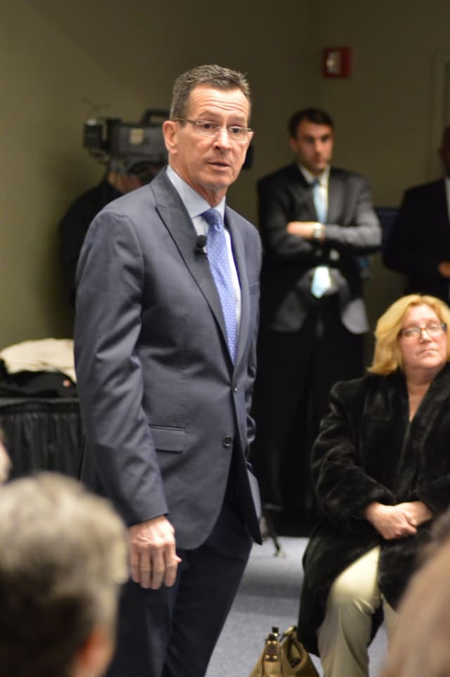 Gov. Dannel Malloy has issued the first round of layoffs in the state.
