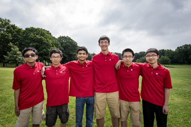 Michael Kural, right of center, with his teammates on the U.S. Math Team.