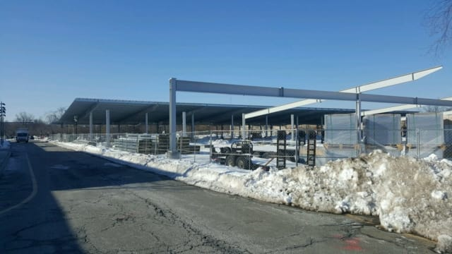 Solar panels are going up over parking spaces at the Paramus Park Mall.