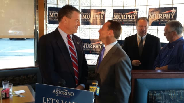 County Executive Rob Astorino,shakes hands with state Senate candidate Terrence Murphy of Yorktown, left, at the Thornwood Diner.